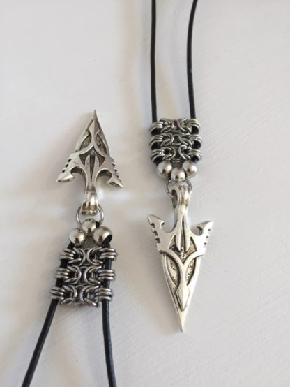 matching arrowhead pendants