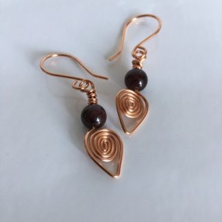 Copper coil earrings garnet