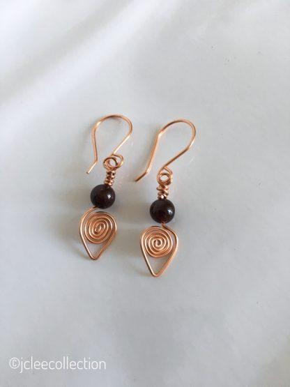 Copper coil earrings garnet